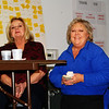 Debbie Blank | The Herald-Tribune<br /> Marcy Wurtz (from right), Southeast Indiana Health Center Drawdown Fundraiser creator and coochair; Norma Nobbe and many other volunteers keep the evening moving along. A thank you sign behind them denotes contributors. Former SEIHC nurse practitioner Beverly Metze won the evening's top cash prize, $3,000.