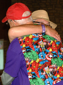"Debbie Blank | The Herald-Tribune Announcer Jim Scott (left) embraces his friend, Dan Toon, Guilford, who has Alzheimer's, after reading a proclamation from Mayor Mike Bettice, that said, in part, ""Our vision is a world without Alzheimer's disease. As John Lennon said, 'Just imagine.'"""