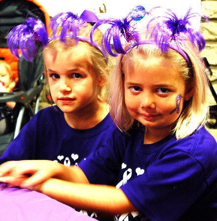 Debbie Blank | The Herald-Tribune Cousins Ella Neirman (left), Henryville, and Elaine Prickel, Indianapolis, wore matching headbands in the color of the day.