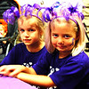 Debbie Blank | The Herald-Tribune<br /> Cousins Ella Neirman (left), Henryville, and Elaine Prickel, Indianapolis, wore matching headbands in the color of the day.