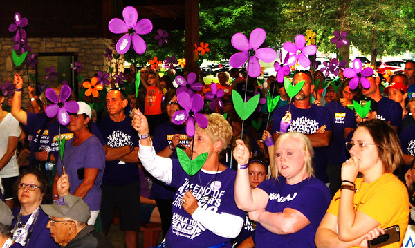 "Debbie Blank | The Herald-Tribune<br /> The Cincinnati chapter director, whose husband was diagnosed with early onset Alzheimer's at 50, said, ""Look around at this beautiful sea of purple. I know I'm not in this alone."""