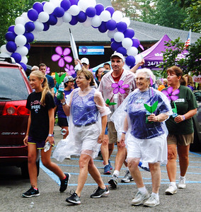 Debbie Blank | The Herald-Tribune After several claps of thunder, rain started to pelt down just as participants were leaving the park. But the walk itself was just symbolic. The hard work of collecting dollars to further the care, support and research efforts of the Alzheimer's Association was already finished.