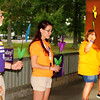 Debbie Blank | The Herald-Tribune<br /> During the opening ceremony, four persons led participants in holding up their Promise Garden Flowers, whose colors represented the person's relationship to the disease: (from left) Dan Toon (blue: I have Alzheimer's or dementia), Kristy Crum (purple: I have lost someone to Alzheimer's or dementia), Sarah Riehle (yellow: I am currently caring for someone with the disease) and Debbi Starkey (orange: I believe in a world without Alzheimer's).