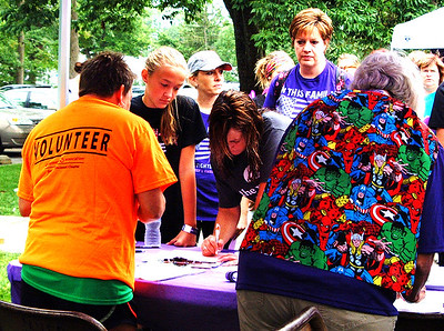 Debbie Blank | The Herald-Tribune Participants check in at the registration table.