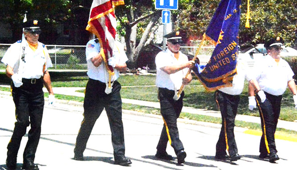 Will Fehlinger | The Herald-Tribune<br /> Leading the Summerfest parade were members of the Batesville Veterans of Foreign War.