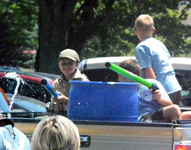 Will Fehlinger | The Herald-Tribune Members of Boy Scouts of America's Troop 634 have a time with water guns as Saturday temperatures were pushing 90 degrees.