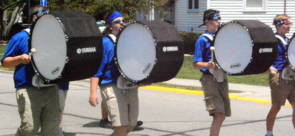 Will Fehlinger | The Herald-Tribune<br /> The Batesville High School Marching Band percussionists look to stay cool under Saturday's sun.