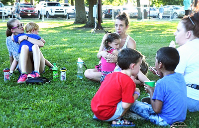 Photo courtesy of Rich Fowler | Brush & Palette Frame Shop Families kept cool by relaxing with drinks under Liberty Park's abundant trees.