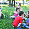 Photo courtesy of Rich Fowler | Brush & Palette Frame Shop<br /> Families kept cool by relaxing with drinks under Liberty Park's abundant trees.