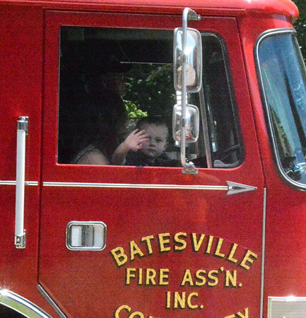 Will Fehlinger | The Herald-Tribune This aspiring fireman greeted parade watchers from his perch on Batesville's Engine 48.