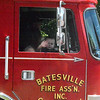 Will Fehlinger | The Herald-Tribune<br /> This aspiring fireman greeted parade watchers from his perch on Batesville's Engine 48.