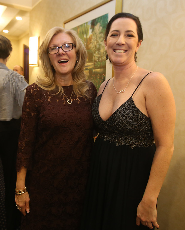 . American Foundation for Suicide Prevention gala fundraiser. Event organizer Nancy Cook of Westford, left, and keynote speaker Kristin Leary, retired from the Chelmsford Police Department. (SUN/Julia Malakie)
