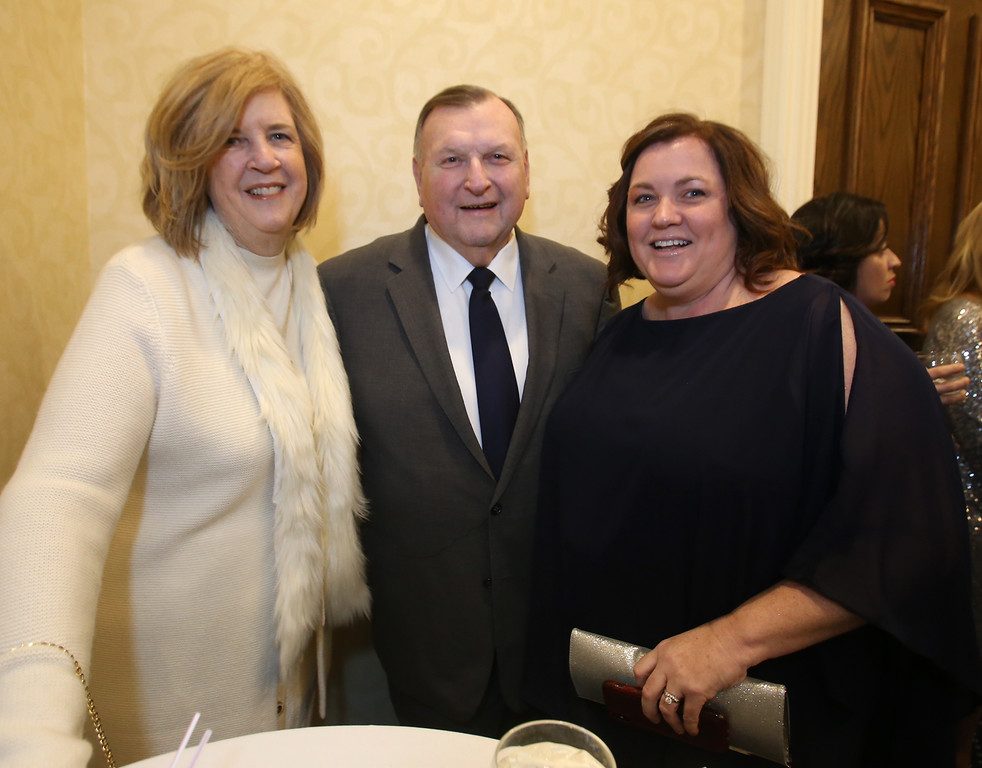 . American Foundation for Suicide Prevention gala fundraiser. From left, Kathleen and husband Terry McCarthy, president of Lowell Sun Charities, and Megan Guthrie of Westford. (SUN/Julia Malakie)
