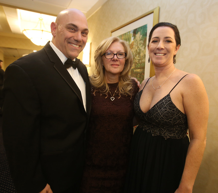 . American Foundation for Suicide Prevention gala fundraiser. From left, Bill Luppold of Tyngsboro, event organizer Nancy Cook of Westford, and keynote speaker Kristin Leary, retired from the Chelmsford Police Department. (SUN/Julia Malakie)