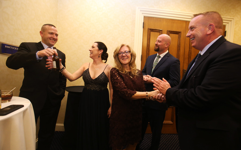. American Foundation for Suicide Prevention gala fundraiser. From left, Justin Ellenton from NEMLEC, keynote speaker Kristin Leary, retired from the Chelmsford Police Department, event organizer Nancy Cook of Westford, and Nick Ziminsky and Lenny Smith, also with NEMLEC. (SUN/Julia Malakie)
