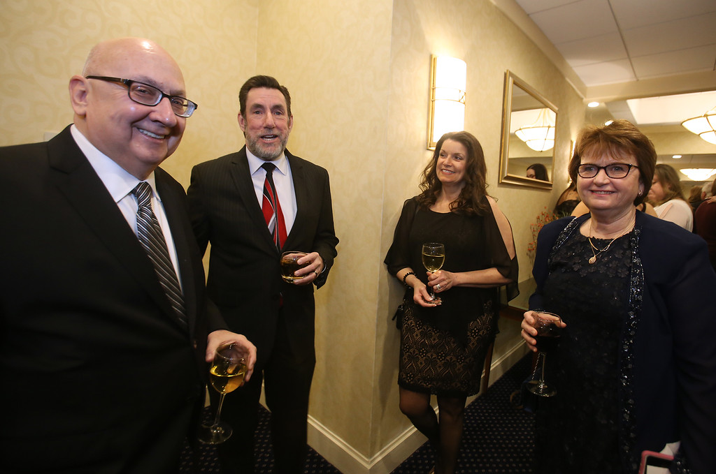 . American Foundation for Suicide Prevention gala fundraiser. Boston Herald editor in chief Joe Sciacca, left, and his wife Kathy Sciacca, right, and Herald and Lowell Sun publisher Kevin Corrado, and his wife Angela Corrado, center. (SUN/Julia Malakie)