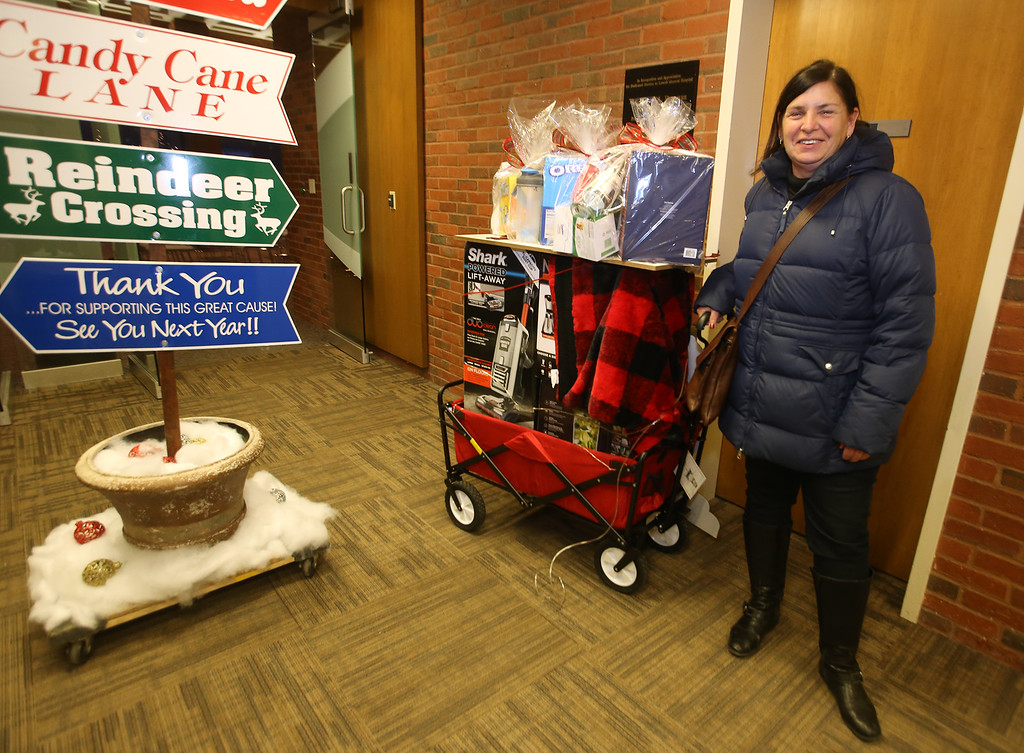 . LGH CEO Jody White announces the winners at the drawing for the LGH/Sun Santa basket raffle. (SUN/Julia Malakie)