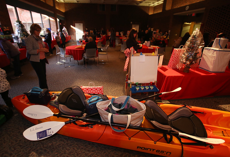 """Raffle tickets for sale at LGH, for Sun Santa baskets put together by Lowell General Hospital departments. """"Santa's Ultimate Sleigh"""" basket includes a kayak. (SUN/Julia Malakie)"""
