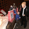 Raffle tickets for sale at LGH, for Sun Santa baskets put together by Lowell General Hospital departments. Margaret Janas and her great-nephew Kasch Atamian, 4, both of Lowell, look at baskets. (SUN/Julia Malakie)
