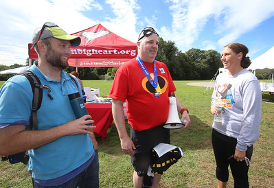 5th annual Middlemiss Big Heart 5K, at Dracut education complex. From left, Brian Walker of Waterville Valley, N.H., college roommate of Scott Middlemiss of Dracut, center, and Michelle Olsen of Westford. (SUN/Julia Malakie)