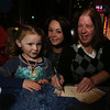 """Steve Panagiotakos' annual fundraiser for Sun Santa and """"It's All About the Kids Foundation"""" at the Blue Shamrock. From left, Adriana Gorham, 3, and her mother Jeannette Gorham of Pepperell, and Jeannette's mother-in-law Marypat Gorham of Lowell. (SUN/Julia Malakie)"""