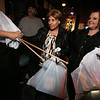 """Pam Marshall of Lowell, center, and her daughter Christine McCarthy of Chelmsford, arrive with presents at Steve Panagiotakos' annual fundraiser for Sun Santa and """"It's All About the Kids Foundation"""" at the Blue Shamrock. (SUN/Julia Malakie)"""