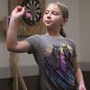 Patriot Dart League's annual tournament/fundraiser for Sun Santa, at the Knickerbocker Club. Vicky Rackliff, 10, of Hudson, N.H., playing for fun.(SUN/Julia Malakie)