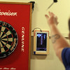 Patriot Dart League's annual tournament/fundraiser for Sun Santa, at the Knickerbocker Club. Donna Lemieux of Dracut competes in Mixed Doubles.(SUN/Julia Malakie)