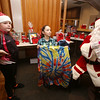 Patriot Dart League's annual tournament/fundraiser for Sun Santa, at the Knickerbocker Club. From left, Halie Baker, 7, of Salem, N.H. and Giselle McHugh, 7, of Lowell, help Santa Claus hand out raffle prizes. (SUN/Julia Malakie)