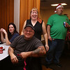 Patriot Dart League's annual tournament/fundraiser for Sun Santa, at the Knickerbocker Club. Audrey Brazel of Dracut laughs as someone she knows wins a second raffle prize. Others from left, Devin Curran of Chelmsford, Eric Bettencourt of Dracut, and Jimmy James of Methuen. (SUN/Julia Malakie)