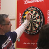 Patriot Dart League's annual tournament/fundraiser for Sun Santa, at the Knickerbocker Club. Tom Curtin of Townsend retrieves his darts during Men's Doubles championship. (SUN/Julia Malakie)