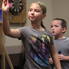 "Patriot Dart League's annual tournament/fundraiser for Sun Santa, at the Knickerbocker Club. Vicky Rackleff, 10, and her brother, ""Moose"" Rackleff, 7, of Hudson, N.H., play for fun. Vicky had already won two kids' events. (SUN/Julia Malakie)"