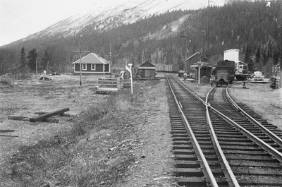 2021.009.PA.024--charles stats 3x4 print [US Army]--ARR--sectionhouse scene--Moose Pass AK--c1951 0000