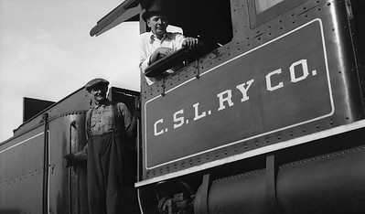 2021.009.02.015D--charles stats PC neg [Doc Yungmeyer]--CSL--Chicago Short Line Superintendent Dan Mead posing with hostler at roundhouse--Chicago IL--1935 0824