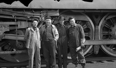 2021.009.02.003--charles stats PC neg [Doc Yungmeyer]--AT&SF--employees posing at Corwith yard--Chicago IL--1938 0410. Left to right: A. Mader; C.N. Schneider; V. Graessle; J. Wojcik.