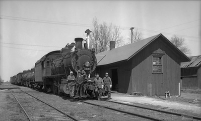 2021.009.02.014--charles stats PC neg [Doc Yungmeyer]--CS&StL--Chicago Springfield & St Louis steam locomotive with freight train at depot with crew posing--Palmyra IL--1940 0420