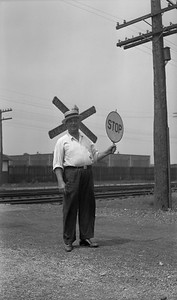 2021.009.02.015--charles stats PC neg [Doc Yungmeyer]--C&WI--flagman Matthew Roberts at 136th and Brainerd Ave--Hegewisch IL--1935 0728