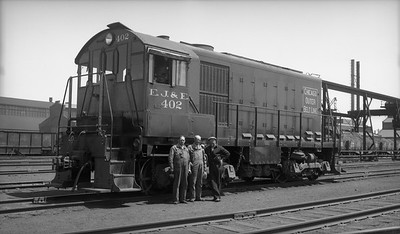2021.009.02.019--charles stats PC neg [Doc Yungmeyer]--EJ&E--ALCO diesel switcher locomotive 402 with crew posing--Gary IN--1938 0501. J.C. Kriger; George Buxton; Charles Faber.