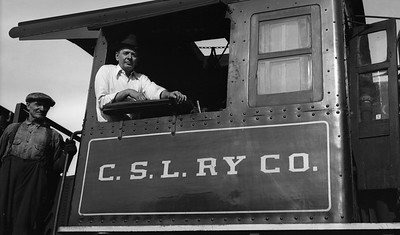 2021.009.02.015C--charles stats PC neg [Doc Yungmeyer]--CSL--Chicago Short Line Superintendent Dan Mead posing with hostler at roundhouse--Chicago IL--1935 0824