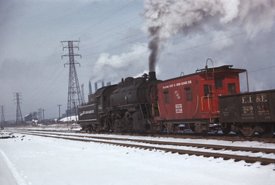 2021.009.1.243--charles stats 35mm kodachrome [Don Davis]--IH&IR--steam locomotive 0-8-0 7296 with caboose switching freight cars action--Hammond IN--1954 1230
