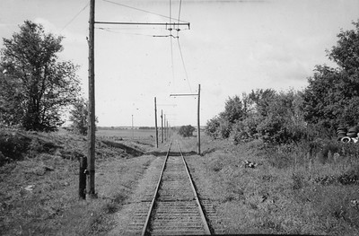 2021.009.PT.021--charles stats 3x5 print--CCW--Charles City Western right-of-way view from train--near Charles City IA--1951 0915