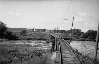 2021.009.PT.022--charles stats 3x5 print--CCW--Charles City Western wooden trestle and right-of-way from train--near Charles City IA--1951 0915