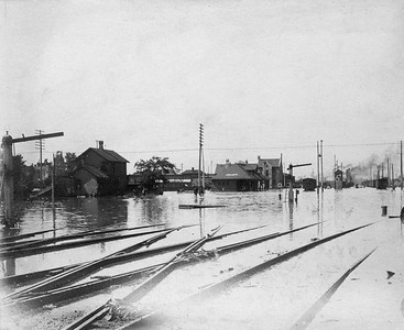 2021.009.CC.006--charles stats 4x5 cabinet card--CRI&P--depot and yard flooded scene--Joliet IL--no date