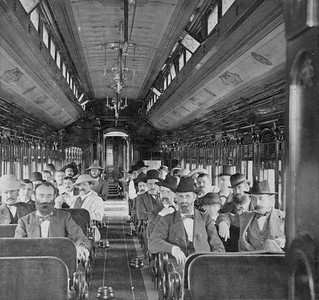 2021.009.RPPC.005--charles stats stereograph--StLSW--passenger car interior--no date