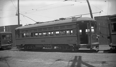 2021.009.4.024--charles stats 116 neg [Raymond Colombe]--CNS&M--streetcar 313 at carbarn--North Chicago IL--1938 0600