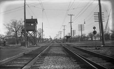2021.009.4.014--charles stats 116 neg [Raymond Colombe]--CNS&M--Shore Line Route looking south grade crossing scene with C&NW at left--location unknown--c1938 0000