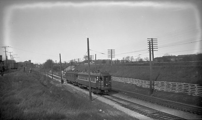 2021.009.4.018--charles stats 116 neg [Raymond Colombe]--CNS&M--southbound interurban train departing Pettibone enginehouse and yard at left--North Chicago Jct IL--c1938 0000