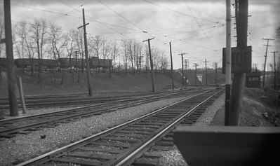 2021.009.4.021--charles stats 116 neg [Raymond Colombe]--CNS&M--yard scene with C&NW freight train in distance looking south--North Chicago Jct IL--c1938 0000