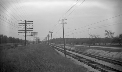 2021.009.4.022--charles stats 116 neg [Raymond Colombe]--CNS&M--view of right-of-way looking north C&NW on left--Lake Bluff IL--c1938 0000