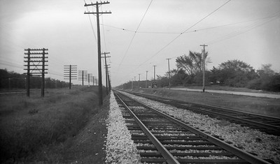 2021.009.4.008--charles stats 116 neg [Raymond Colombe]--CNS&M--view of right-of-way looking north at Shore Line Route C&NW at left Skokie Valley at far left----c1938 0000